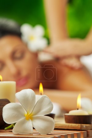 Photo for Portrait of young beautiful woman in spa environment. focused on candles - Royalty Free Image