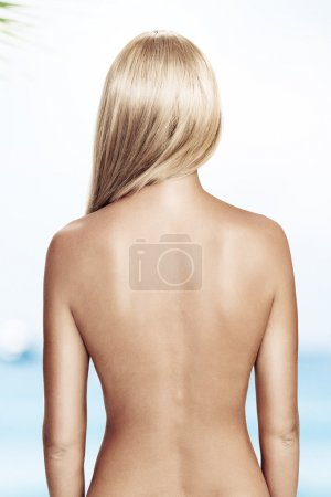 View of nice young wonam back on white back