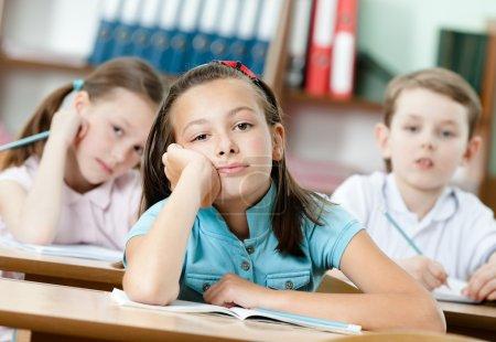 Tired beautiful schoolgirl dreams