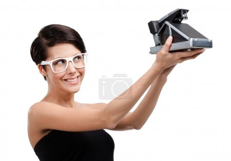Woman takes photos with cassette photographic camera
