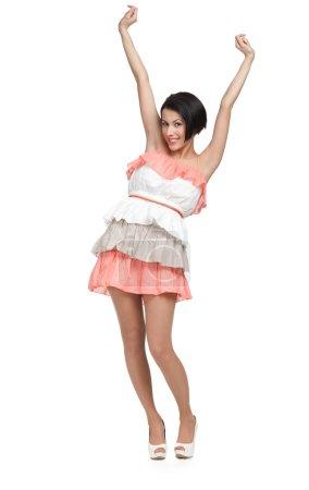 Photo pour Danse fille en robe colorée, isolé sur blanc - image libre de droit