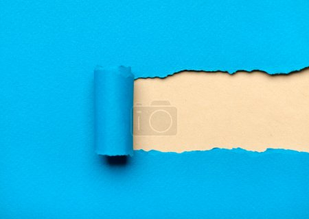 Ripped blue paper with milky space for message