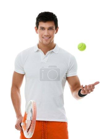 Sporty sportsman playing tennis