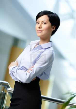 Photo for Portrait of a handsome professional business woman wearing white shirt and black skirt at business centre - Royalty Free Image