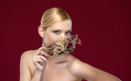Woman with patterned masquerade mask