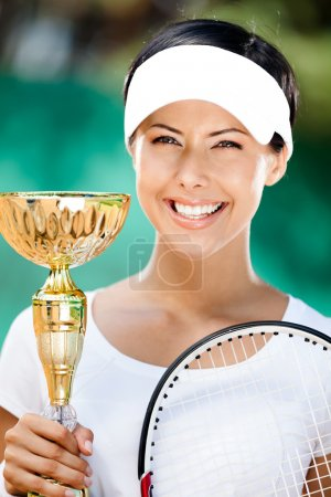 Young female tennis player won the cup