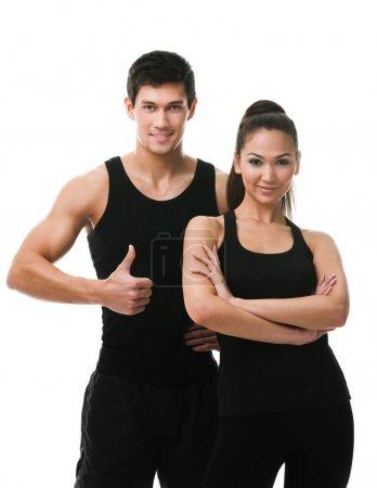 Photo pour Deux sportifs en tenue de sport noire, isolés sur blanc - image libre de droit