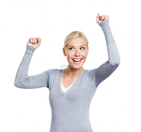 Photo for Half-length portrait of girl with her fists up, isolated on white. Sign of happiness and success - Royalty Free Image