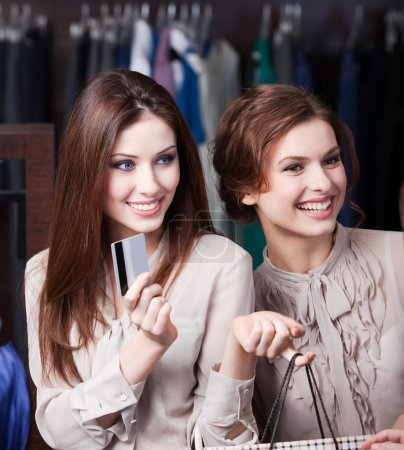 Pretty women have credit card to pay for all bargains