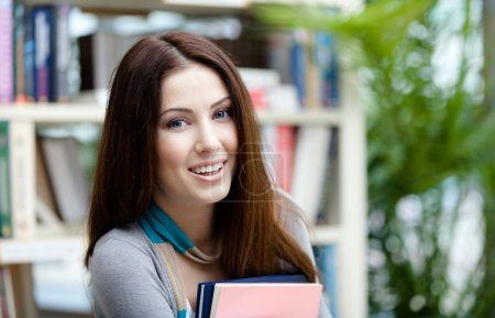 Female student keeps books