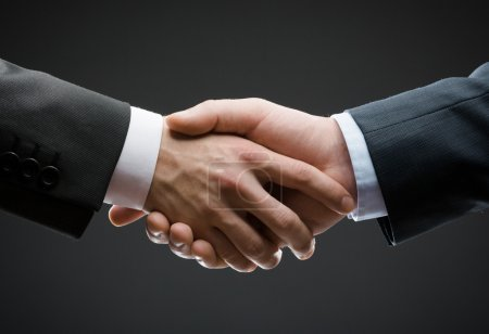 Close up of hand shake