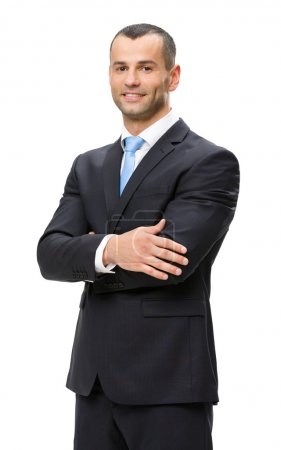 Half-length portrait of business man with hands crossed