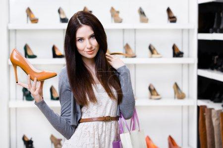 Woman keeping stylish pump