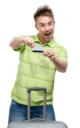 Man with travel trunk and credit card