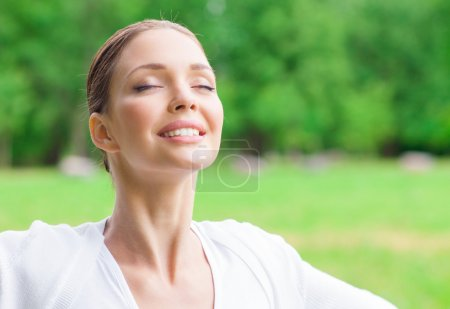 Photo for Portrait of woman with eyes closed. Concept of healthy lifestyle and relaxation - Royalty Free Image