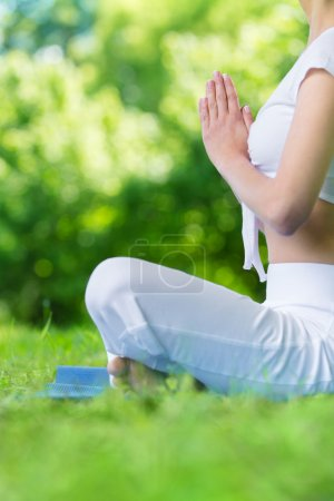 Photo for Profile of woman who sits in asana position prayer gesturing. Concept of healthy lifestyle and gratitude - Royalty Free Image
