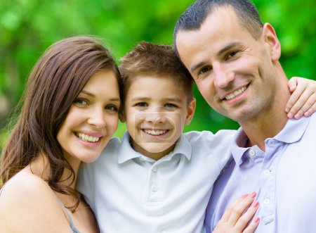 Photo for Portrait of family of three. Concept of happy family relations and carefree leisure time - Royalty Free Image