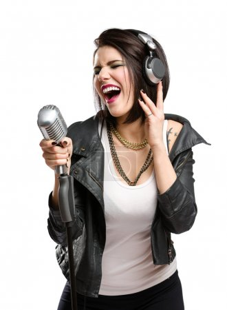 Rock singer with mic and earphones