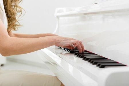 Closeup of hands playing piano
