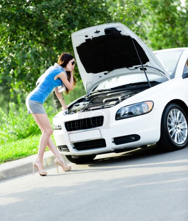 Woman repairing the broken car
