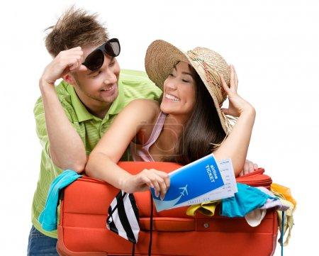 Couple packs suitcase