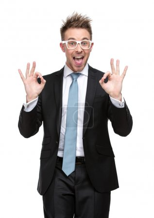 Businessman in glasses OK gesturing