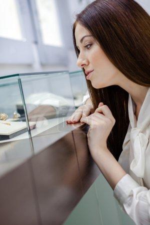 Woman at jeweler shop.