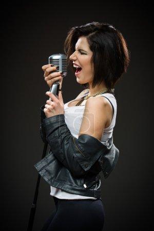 Female rock musician keeping mike