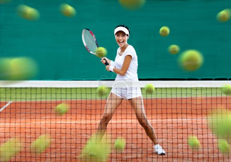 Sportswoman returning lots of tennis balls
