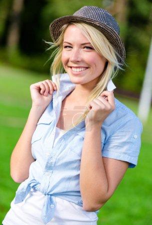 Portrait of pretty blond girl wearing hat
