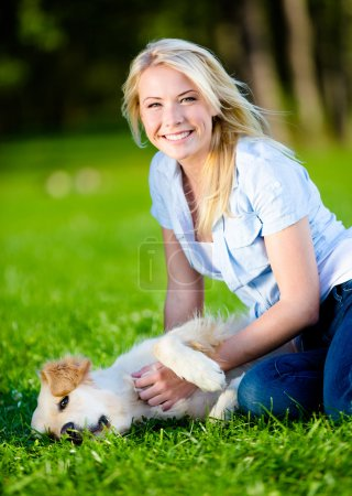 Woman with retriever in the park