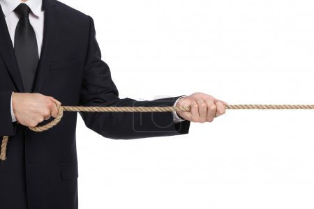 Close up of businessman pulling the rope