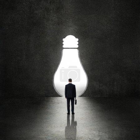Light bulb before the businessman