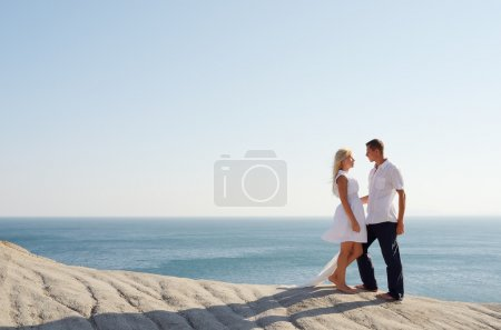 Girl and a guy going out at the sea