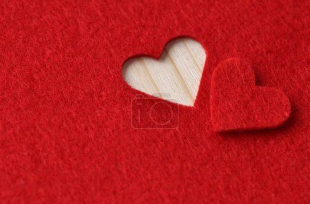 Photo pour Background for design to Valentine's Day. Decorative heart from red felt - image libre de droit