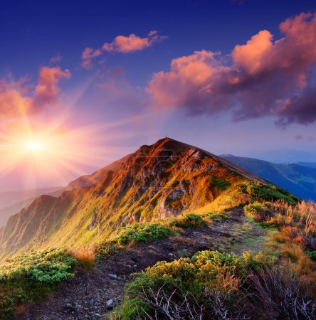 Photo for Beautiful summer sunrise in mountains. Path along the ridge leading to summit - Royalty Free Image