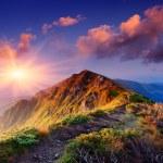 Beautiful summer sunrise in mountains. Path along ...