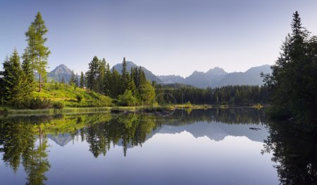 Photo for Panorama of a beautiful lake in a mountain resort surrounded by woods. Slovakia, lake Strbske Pleso less - Royalty Free Image