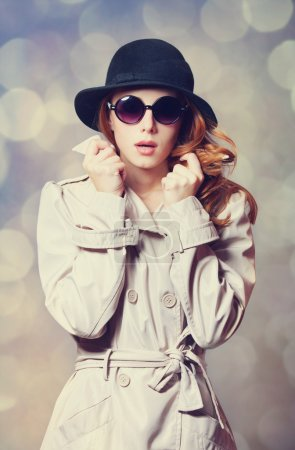 Redhead girl in cloak as a spy