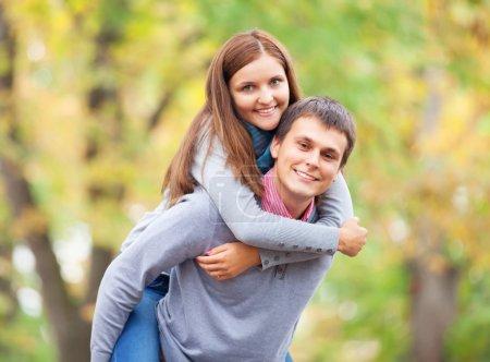 Teen couple at autumn park