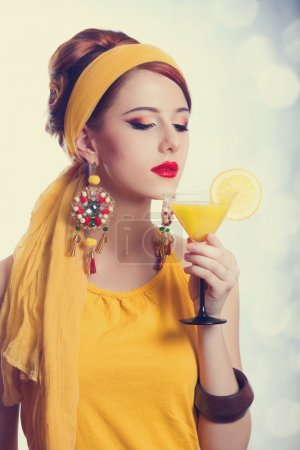 Beautiful redhead women with cocktail