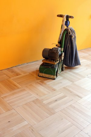 Machine sanding wood floor.Renovation of house