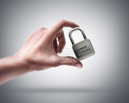 Photo for Man's hand holding lock password - Royalty Free Image