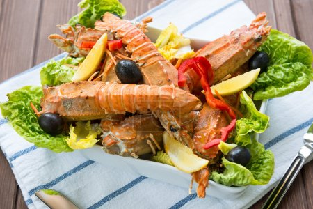 Photo for Lobster salad with olives, capsicum and iceberg lettuce - Royalty Free Image