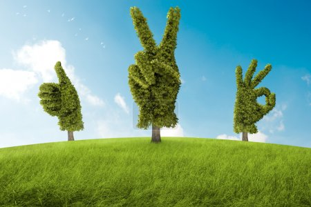 Photo for Trees in the shape of hand that ago a positive gesture - Royalty Free Image