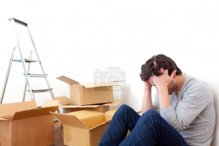 Young man depressed while his moving out his flat