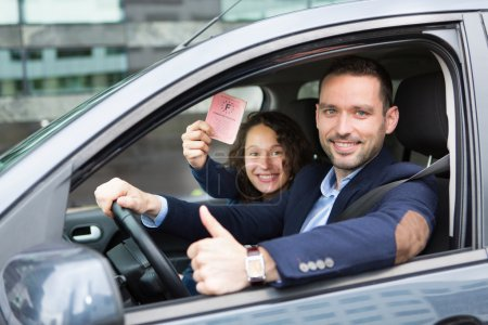 Driver in his car after getting his driving licence