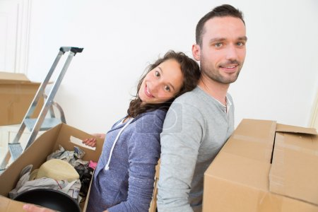 Photo for View of a Young couple in love moved in their new flat - Royalty Free Image