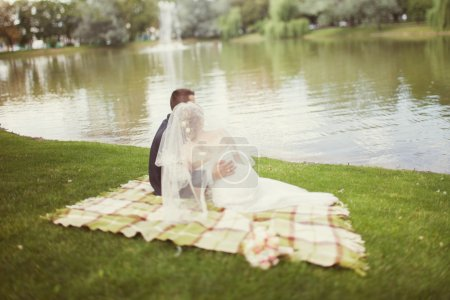 Bride and groom  near the lake