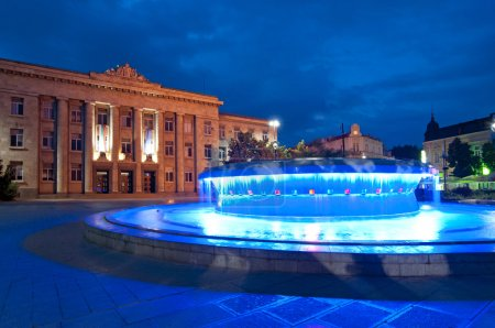 Photo for Ruse, Bulgaria - water fountain at dusk in city center - Royalty Free Image